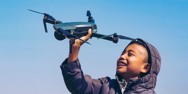 kid-holding-up-drone